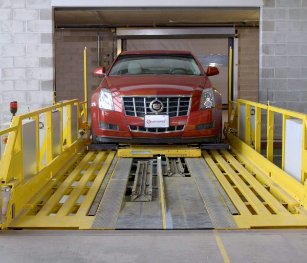 Car being transported to lift in automated parking solution