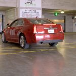 Car approching parking bay in automated parking garage