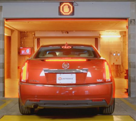 Car entering parking bay in automated parking garage