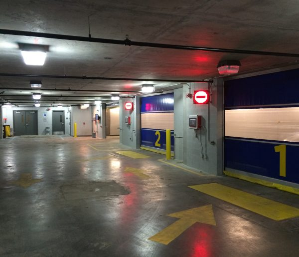 Inside of Unitronics automated parking garage with bay doors